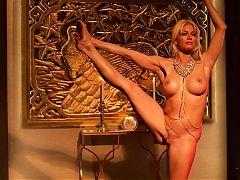 Busty blonde does nude yoga and masturbates