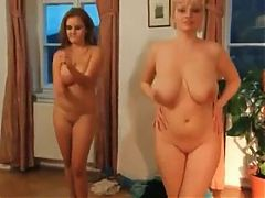 Two busty beauties dancing nude together